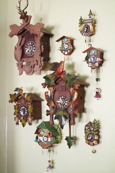 Who doesn't love a cuckoo clock?, or three.--I think this would drive my boyfriend crazy if I did this. Old Clocks, Antique Clocks, Cuckoo Clocks, Vintage Clocks, Coo Coo Clock, Tick Tock Clock, Clock Display, Time Clock, Displaying Collections