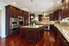 Kitchen In Luxury Home With Cherry Wood Cabinetry Royalty Free Stock Photo, Pictures, Images And Stock Photography. Image 6740007.