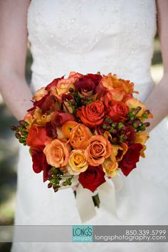 these were the colors i chose when brian and i married. i loves reds and deep oranges together.