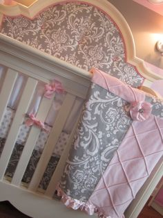 My guest room isn't going to be a nursery, but I do love this pink and grey themed baby room.  Ahh.