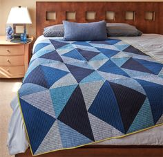 The Flying Geese block gets a modern makeover in this bed quilt by Nichole Ramirez with this quilt pattern download.
