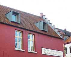 Modern dormer windows in a 17th century building, nice contrast