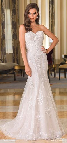 Highlight your figure in this sequined tulle fit and flare gown showcasing a sweetheart neckline, low back, scalloped hem, and chapel length train.