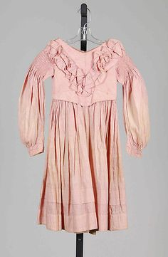 Pink Cotton Girl's Dress, circa 1837-39   From the very first years of Victoria's reign, this 1830s dress has banded-down gigot sleeves and a slight dip at the front of waist. #Early #Victorian #1830s