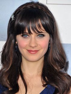 Zooey Deschanel adds a plaited headband on top to glam up her blunt bangs and wavy hair.