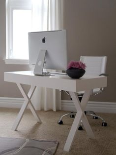 """Choosing a white desk and chair is a smart strategy if you don't want to add too much visual weight to a room. The clean lines of these pieces also make them feel light and airy."""
