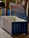great storage for gardening or pool toys. Looks like it could be made from pallets.