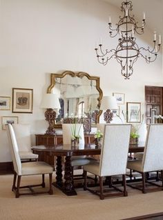 A large table and comfortable chairs create the perfect dining room for entertaining in this Mediterranean inspired home.