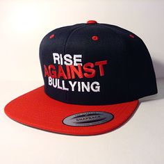 This hat is a red and black snapback!  Available now at www.blankhatsforcharity.com