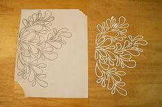 Print out a pattern you like, place a sheet of wax paper over it and trace the pattern with puffy paints. When it dries peel it off the wax paper and apply it to it's permanent surface.