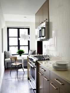 A bright modern kitchen with grounding neutrals, and a dinning nook