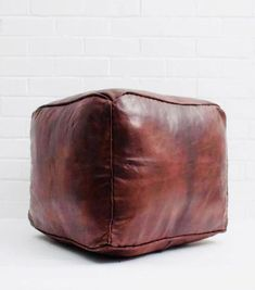 The Moroccan Leather Plain Square Pouffe in Chocolate, a traditional leather pouf design with a contemporary twist. This best selling ottoman is organically tanned or dyed, and hand-stitched by artisans in Morocco. Moroccan Pouffe, Moroccan Leather Pouf, Brown Ottoman, Leather Ottoman, Pouf Ottoman, Bohemia Design, Ikea, Square Pouf, Natural Leather
