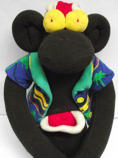 Hawaiian zombie sock monkey.