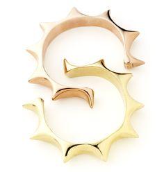 Gold and bronze sun cuffs by jewelry designer Pamela Love