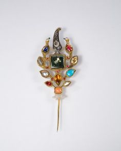 Turban Ornament (sarpech)    19th century    Northern India    Whitish nephrite jade, with gems set in gold; gilded metal pin, 12.6 cm