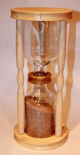 Tutorial for making an hourglass from discarded bottles....  The FABULOUS Blog of Miss Ginger Grant!: Like Sands Through the Hourglass.... !