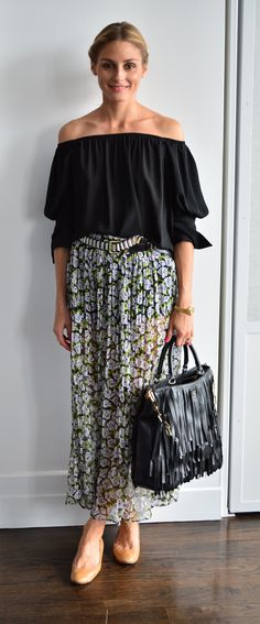 wearing a black top and belt by Zara with a Vintage skirt, Pretty Ballerina flats and a Carolina Herrera bag.