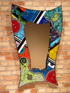 """The bases are made of laminated foam and masonite, an incredibly rigid material.  The glass mosaic pieces are not assembled of broken, random bits, rather their shapes are painstakingly cut so that they precisely interweave.  The result is an artwork that transcends """"craftiness,"""" yet is distinct from traditional Roman-style mosaic. The edges of the mirrors measure 2.5 inches to the wall, and are completely surrounded with glass strips, forming a beautiful border."""