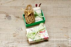 A cheery floral vintage match box tied with ribbon and a silk flower, the inner drawer inside has a tiny guide for attracting Honey bees to your garden and a crochet basket