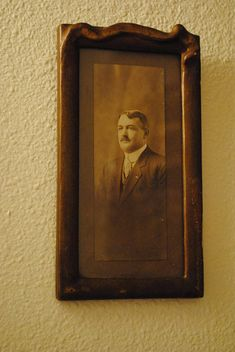 Framed portrait of gentleman in a suit