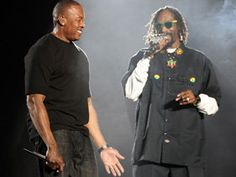 Tupac Takes Coachella Stage Via Hologram With Dr. Dre, Snoop Dogg  The pair's historic set also included surprise guests Eminem, 50 Cent and Wiz Khalifa.