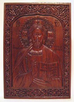 Carved icon The Lord Almighty 8.8×12.9×1 cm; eucalyptus wood, natural linen oil varnish, 2003. Artists are Elena and Sergio Nikolenko