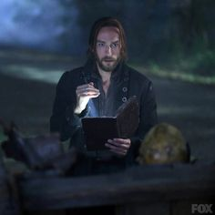 Ichabod and Abbie begin The Kindred incantation. - Well I can say he's reading if I want to!  :)