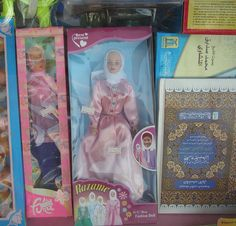 Kingdom of Saudi Arabia, 2006. The window of a toy shop displays on the right the official religion's holy book, incidentally the only one allowed to be sold here. Even dolls conform to the local dress codes and make for a very popular item with little girls.