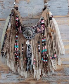 This native american style bag fits very nicely when worn as a cross body bag or on the shoulder. It is an original accessory for hippie style or festival lovers or any self-confident women that are not afraid to stand out. It looks perfect particularly in combination with a midi dress or a