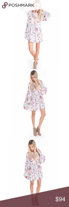 🆕 Long Sleeve Feather Print Dress This beautiful powder blue feather print dress features long bell sleeves, a scoop neckline, a flowy fit, and it ties behind the neck.  💕 100% Polyester 💕 Model is wearing a Small. buddy love Dresses Long Sleeve