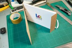 Portfolio of Luis Azevedo, a photographer in Portugal.  Photography portfolio made out of cardboard and elastic.