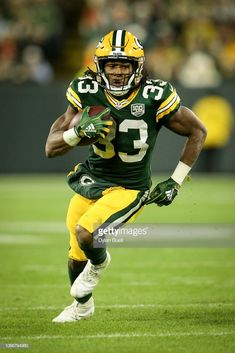 Aaron Jones of the Green Bay Packers runs with the ball in the third. e768898ec