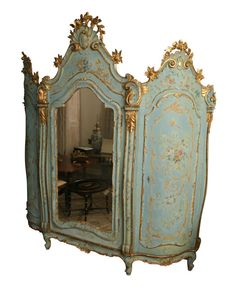 1stdibs | 19th Century Venetian Painted Armoire with three doors in blue and gilt.