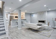 Turning an unfinished basement into extra living space? Learn what to do when finishing basement walls to achieve quality, comfortable conditions. Gray Basement, Basement Paint Colors, Basement Painting, Basement Living Rooms, Modern Basement, Basement Bathroom, Basement Layout, Basement Apartment Decor, Apartment Ideas