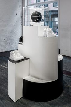 wall-mounted sculpture, shoe risers, fitting room wallpaper, and hanging… Shoe Display, Display Design, Store Design, Adidas Design, Shoe Wall, Store Window Displays, Retail Merchandising, Exhibition Display, Retail Interior