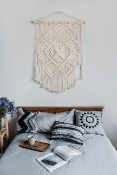This gorgeous modern macrame wall hanging was inspired by the ancient pattern of traditional Ukrainian embroidery. Centuries ago this geometric