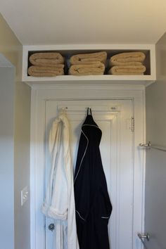 Love this idea for a small bathroom.  Add a shelf above the door.  Great post on how to make this work for you.