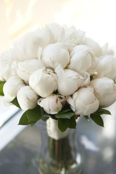 A pure white peony bouquet.                                                                                                                                                                                 Más