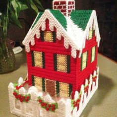 Best 12 This item is a Christmas time/Winter cottage tissue box cover. The cottage part lifts out of the fence so you can put the tissues in, then you set it back in. You can put candies in the yard area. Plastic Canvas Tissue Boxes, Plastic Canvas Crafts, Plastic Canvas Patterns, Plastic Sheets, Christmas Home, Christmas Crafts, Christmas Decorations, Tissue Box Covers, Covered Boxes