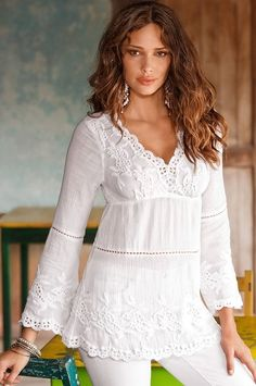 Sensuous lace embroidered tunic with intricate embroidered details along the surplice v-neck, slight bell-sleeve cuffs, and hem. Sheer cotton gauze is lightweight and looks great paired with shorts, jeans, or capri pants.
