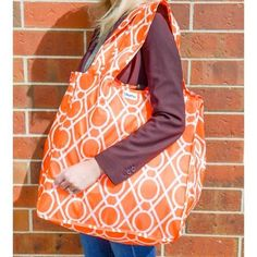 The Large Tote is one of RuMe's first and best selling products. This tote can hold up to 50 pounds, is durable and washable, fun and fashionable! The orange and white pattern is called Clementine. It's one of my favorite designs for Spring time!