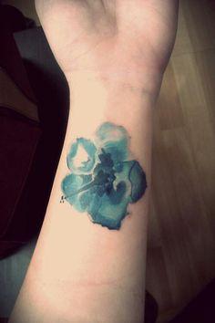 Watercolor tattoo flower