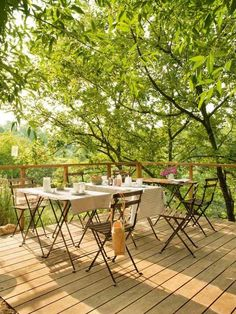 Unpretencious beautiful Wooden deck with outdoor furniture for dining