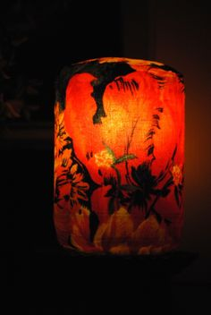 Upcycled Pickle Jar Decorative lamp made with cloth and Mod Podge.