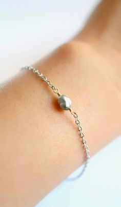 Delicate Tahitian keshi pearl bracelet. Available in three metal finishes. By Kahili Creations of Hawaii...