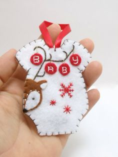**NO LONGER EXCEPTING CUSTOM ORDERS OR ORDERS FOR PERSONALIZATION** This little baby romper ornament was all hand stitched, embroidered, and