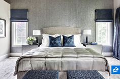 Textured wallpaper behind the bed brings this contemporary room to life.