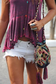 white shorts and a colorful top.