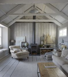 The wood panelled sitting room with logburner is spacious and filled with lightCredit: © Copyright Paul Massey   LIVINGroom WE♥