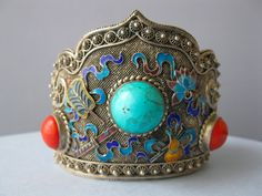A large sterling and turquoise cuff bracelet that was made in China.